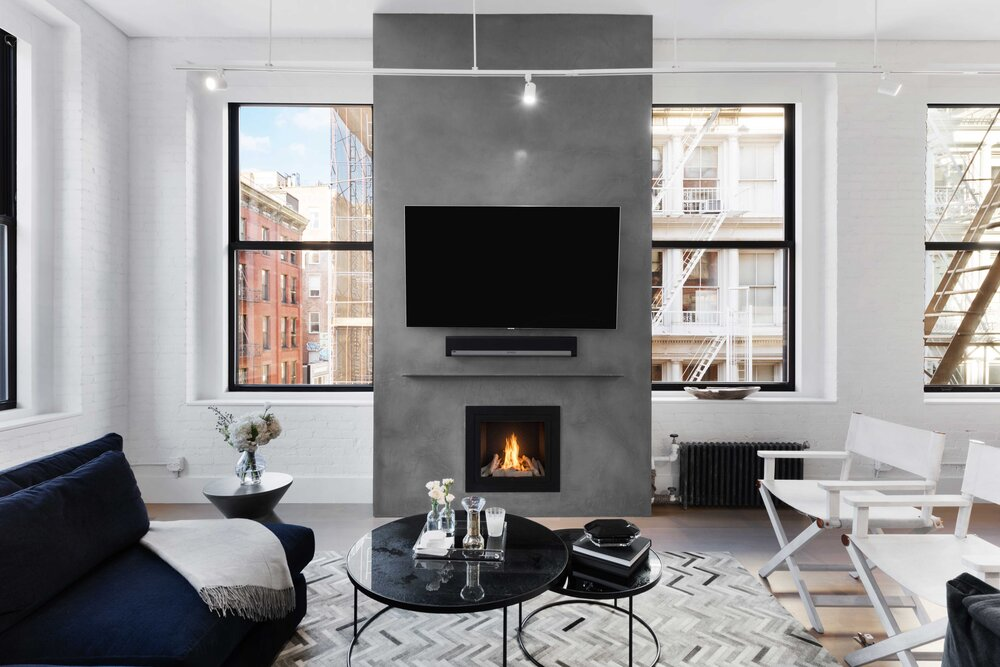 https://mk0hearthcabinej16d7.kinstacdn.com/wp-content/uploads/2020/08/Michasl-Mufson-Design-hearthcabinet-ventless-fireplace-design-luxury-fireplace.jpg